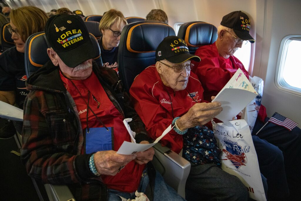 Veterans open mail call onboard Honor Flight